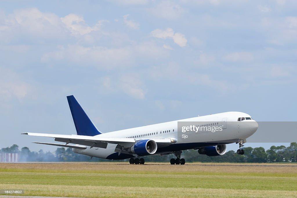 Plane landing : Stock Photo