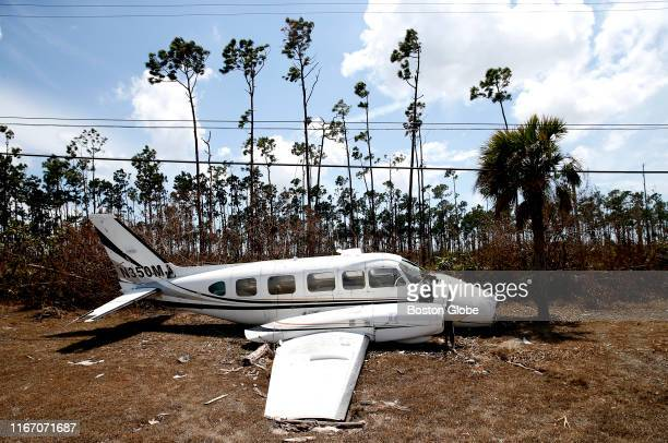 A plane lays on the side of the road across the street from the airport in Freeport Grand Bahamas on Sep 6 2019 Across the Bahamas communities are...