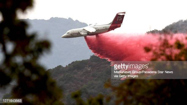 Plane makes a Phos-Chek fire retardant drop in the San Gabriel Mountains during the Bobcat Fire in Monrovia on Wednesday, September 9, 2020.