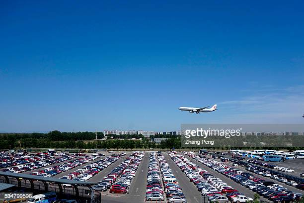 A plane of Air China flies over a parking lot as it cones in to land Air China leading Chinese carrier has transported 802 million passengers in...