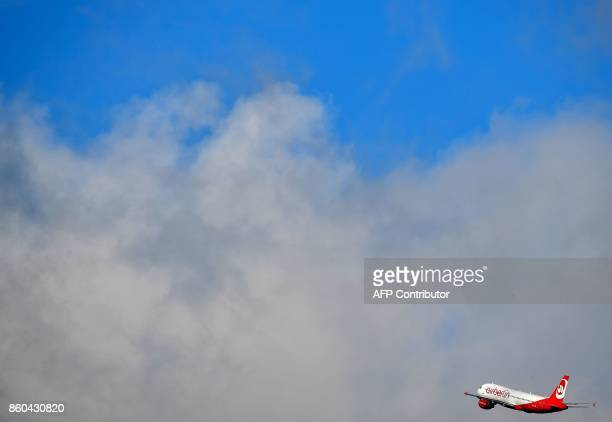 A plane of German airline Air Berlin takes off from Tegel airport in Berlin on October 12 2017 Germany's biggest airline Lufthansa will buy up more...