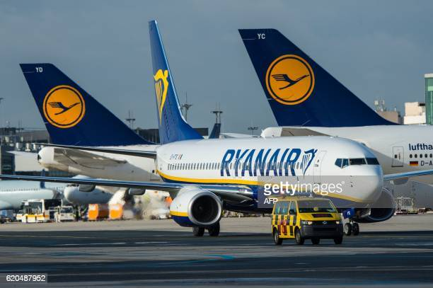A plane of Irish lowcost airline Ryanair stands in front of planes of German airline Lufthansa on November 2 2016 in Frankfurt am Main western...