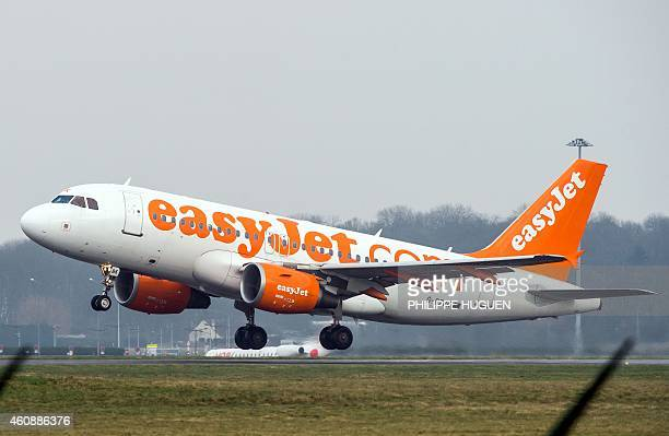 A plane of the low cost airline carrier EasyJet takes off on December 29 2014 at LilleLesquin airport AFP PHOTO PHILIPPE HUGUEN / AFP / PHILIPPE...
