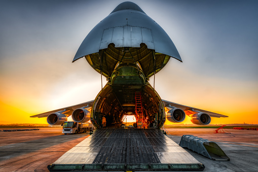 Plane on the ground with wide open freight room 1178750940