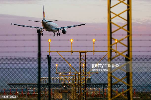 A plane operated by Iberia lands at Aena operated Barcelona El Prat International Airport on February 11 2015 in Barcelona Spain Shares in...