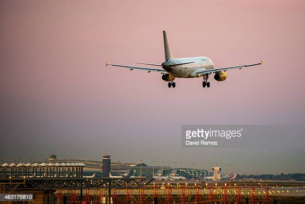 A plane operated by Vueling lands at Aena operated Barcelona El Prat International Airport on February 11 2015 in Barcelona Spain Shares in...