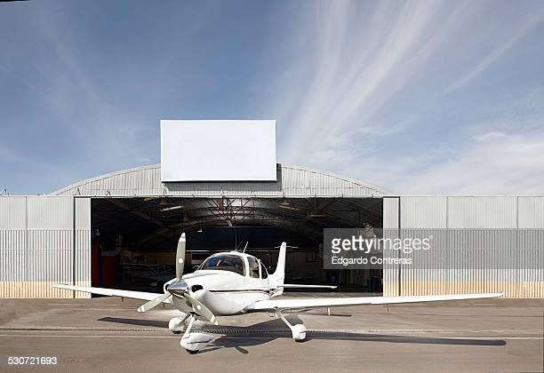 Plane outside of hangar