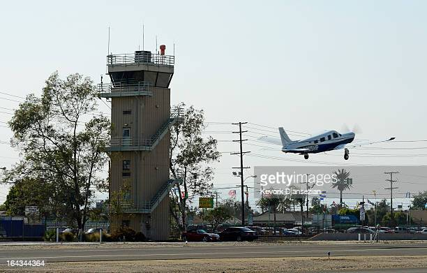 A plane passes the Whiteman Airport control tower as it takes off on March 22 2013 in Los Angeles California The control tower at Whiteman Airport is...