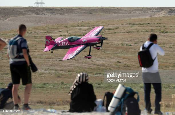 A plane performs a flying display during the Sivrihisar airshow in Sivrihisar district of Eskisehir on September 14 2019