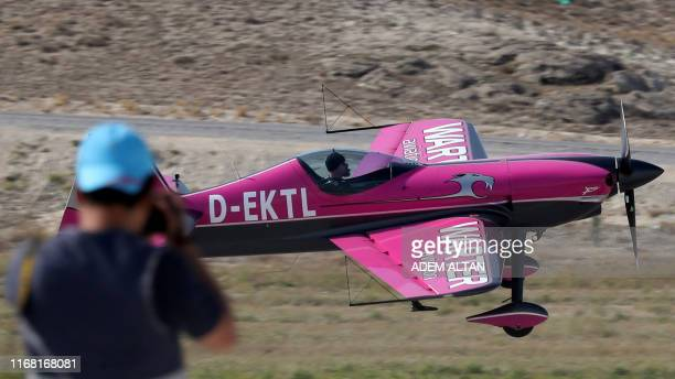 A plane performs during the Sivrihisar Airshow in Sivrihisar district of Eskisehir on September 14 2019