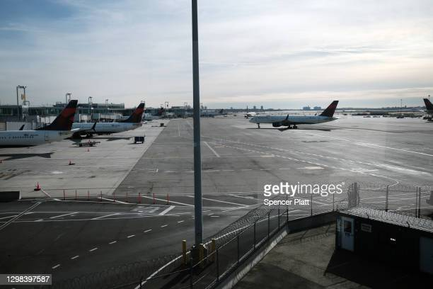 Plane sits on a tarmac at an international terminal at John F. Kennedy Airport on January 25, 2021 in New York City. In an effort to further control...