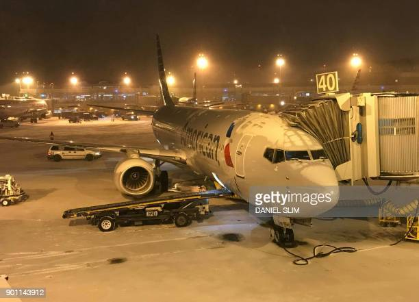 A plane sits on the tarmac at Ronald Reagan airport near Washington DC before departure January 4 2018 The US National Weather Service warned that a...