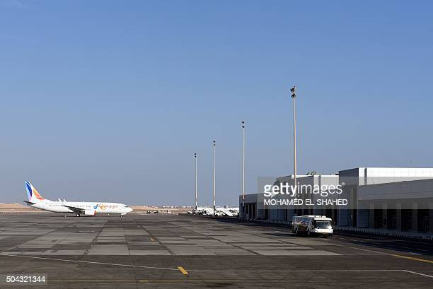 A plane sits on the tarmac at the Hurghada International Airport in Egypt's Red Sea resort on January 10 2016 Two men carrying knifes stormed the...