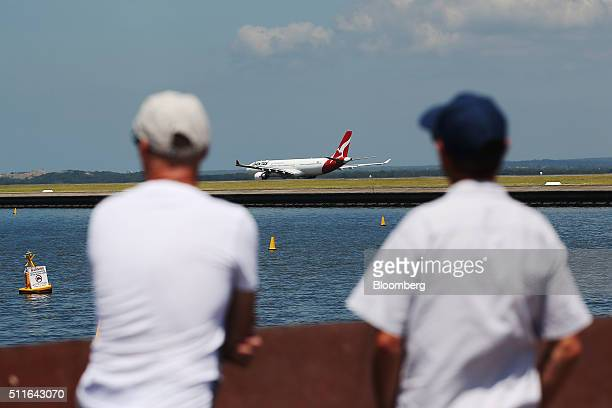 Plane spotters look on as an Airbus A330300 aircraft operated by Qantas Airways Ltd taxis at Sydney Airport in Sydney Australia on Monday Feb 22 2016...