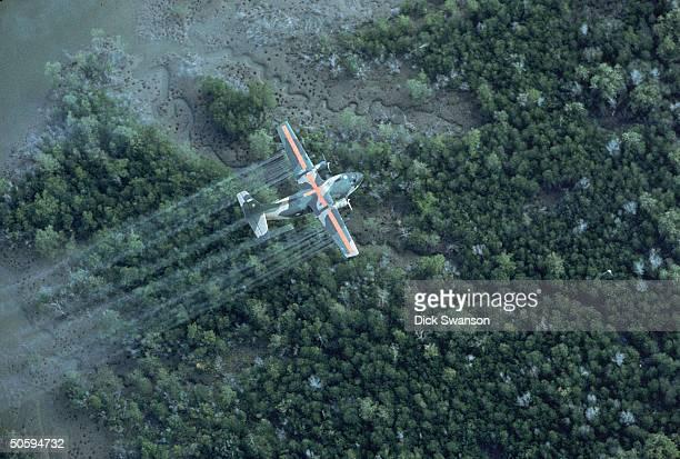 UC 123K plane spraying delta area w dioxintainted herbicide/defoliant Agent Orange in Vietnam war defensive measure 20 MI SE OF SAIGON