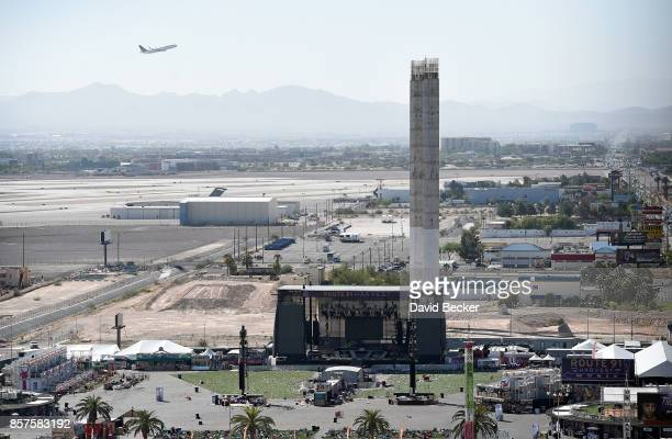 A plane takes off from McCarran International Airport near the site of the Route 91 Harvest country music festival on October 4 2017 in Las Vegas...