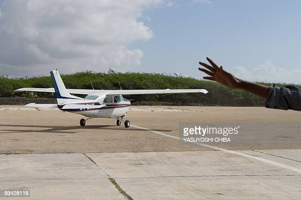A plane takes off from Mogadishu airport on 26 November 2009 with two freelance journalists one from Canada and the other from Australia who were...
