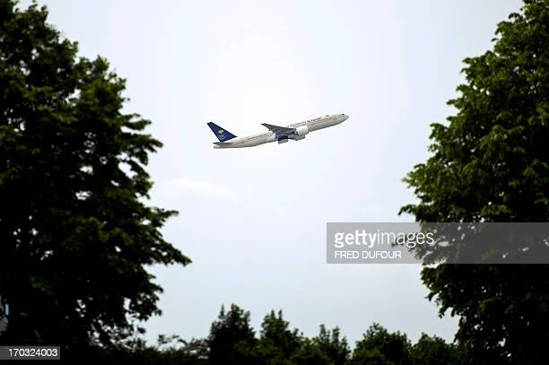 A plane takes off from Roissy Charles de Gaulle international airport in RoissyenFrance outside of Paris on June 11 2013 AFP PHOTO / FRED DUFOUR