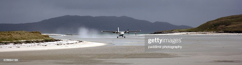 Plane taking off at Barra beach : Stock Photo