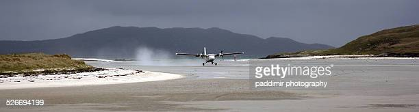plane taking off at barra beach - barra scotland stock pictures, royalty-free photos & images