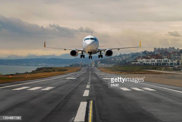 plane taking off from an airport - taxiway stock pictures, royalty-free photos & images