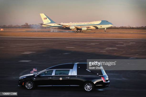 A plane touches down carrying the remains of President George HW Bush at Ellington Field on December 5 2018 in Houston Texas The funeral for Bush who...