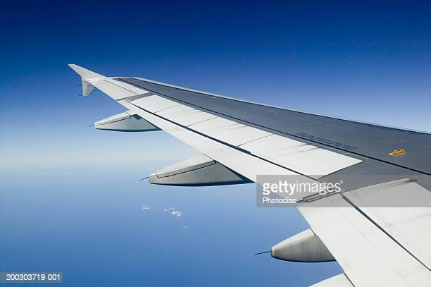 Plane wing seen from plane, aerial view