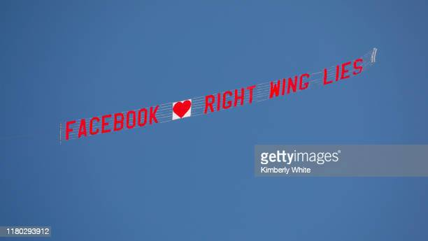 Plane with a message banner passes around Facebook Headquarters on November 5, 2019 in Menlo Park, California.