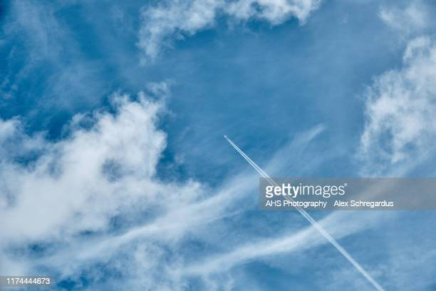plane with contrail with copy space - military stock pictures, royalty-free photos & images