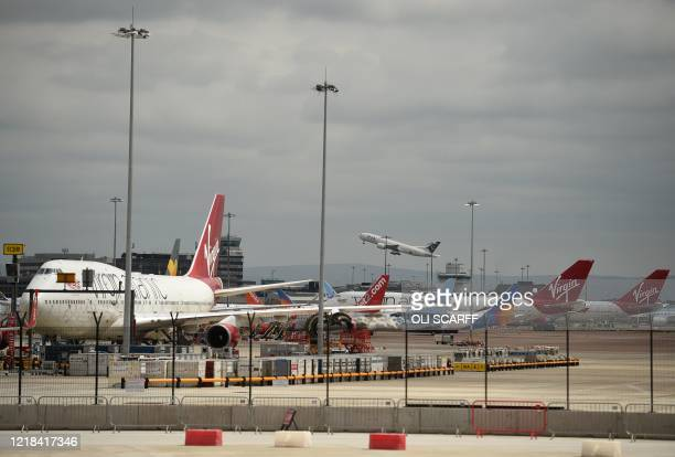 Planes are pictured on the tarmac at Manchester Airport in north-west England, on June 8 as the UK government's planned 14-day quarantine for...