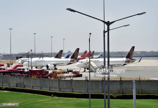 Planes are seen parked at Indira Gandhi International Airport on May 24 2020 in New Delhi India The flight services are resuming from Monday after an...