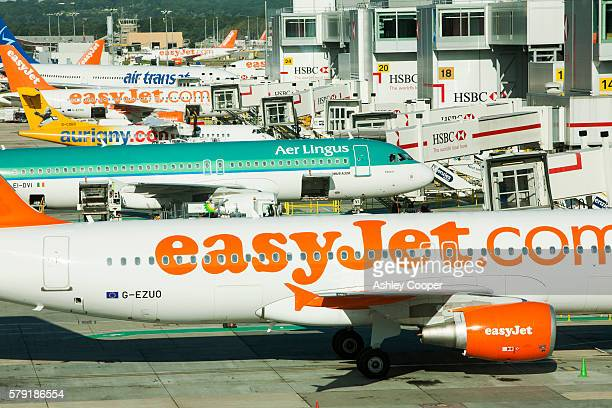 planes at gatwick airport, london, uk. - easyjet stock pictures, royalty-free photos & images