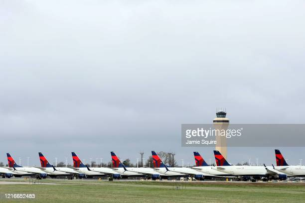 Planes belonging to Delta Air Lines sit idle at Kansas City International Airport on April 03, 2020 in Kansas City, Missouri. U.S. Carriers reported...