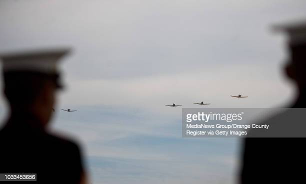 Planes do a missing man formation in memory of 84 military men who died 50 years ago after taking off from El Toro for Vietnam INFO Photo by MINDY...