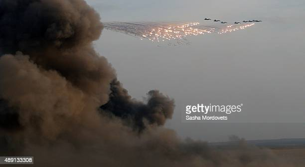 Planes drop bombs during Russias large-scale Center-2015 military exercises at Donguzsky Range September 19, 2015 in Orenburg, Russia, The exercises,...