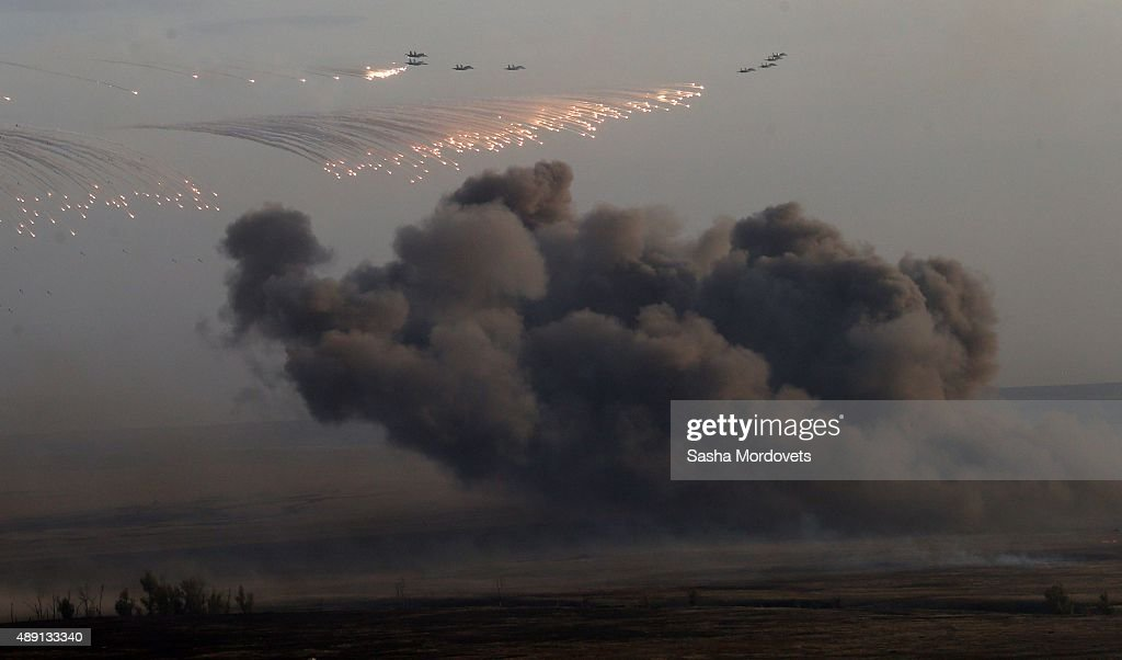 Planes drop bombs during Russias large-scale Center-2015 military exercises at Donguzsky Range September 19, 2015 in Orenburg, Russia, The exercises, aim to contain the outbreak of an armed conflict in Central Asia. Putin said this week that it's impossible to defeat Islamic State group without support of the government of Syria and that Moscow has provided military assistance to President Bashar al-Assad's regime and will continue to do so.