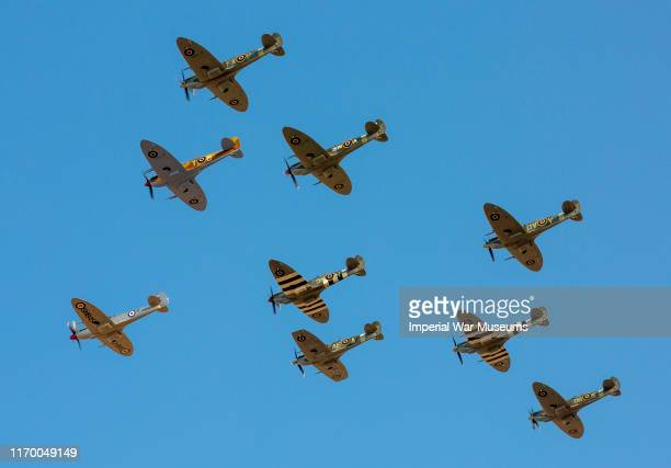 Planes fly during the Duxford Battle of Britain Airshow on September 21 2019 in Duxford EnglandThis year the flying team have recreated the airfield...