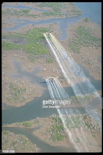 UC 123K planes flying over delta area to spray defoliant Agent Orange 20 mi SE of Saigon