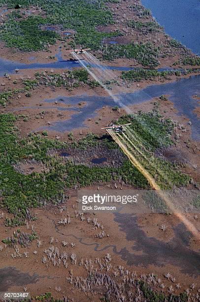 UC 123K planes flying over delta area to spray defoliant Agent Orange 20mi SE of Saigon