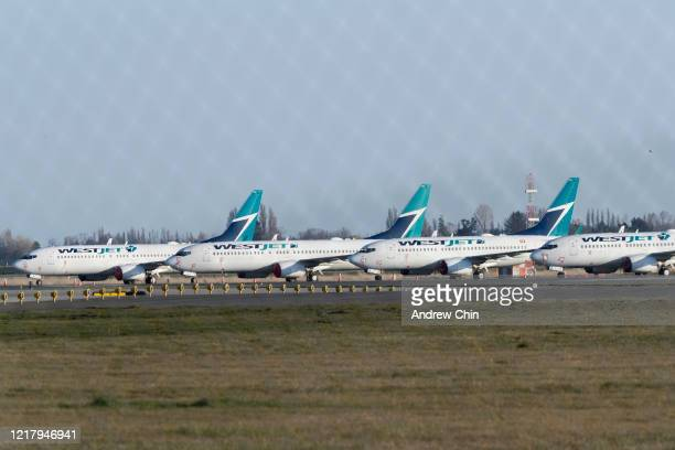 Planes, from Canada's second largest airline Westjet, sit grounded at Vancouver International Airport on April 09, 2020 in Richmond, British...