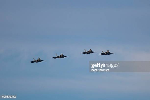 Planes from the 199th Fighter Squadron Hawaii Air National Guard and the 19th Fighter Squadron US Air Force perform a missing man fly over over the...