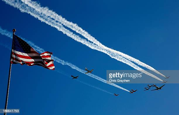 Planes from the Cavanaugh Flight Museum perform a flyover as part of prerace ceremonies for the NASCAR Nationwide Series O'Reilly Auto Parts 300 at...
