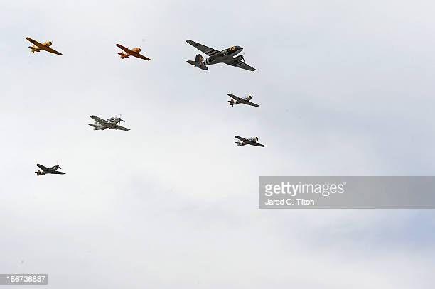 Planes from the Cavanaugh Flight Museum perform a flyover as part of prerace ceremonies for the NASCAR Sprint Cup Series AAA Texas 500 at Texas Motor...