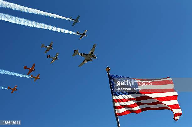 Planes from the Cavanaugh Flight Museum perform a flyover during prerace ceremonies for the NASCAR Nationwide Series O'Reilly Auto Parts 300 at Texas...