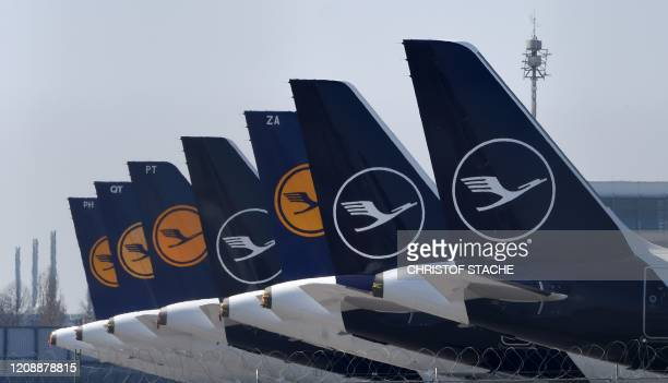 "Planes of the German airline Lufthansa are parked at the ""Franz-Josef-Strauss"" airport in Munich, southern Germany, on April 1, 2020. - Just a few..."