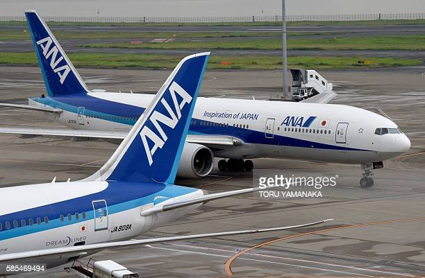 Planes of the Japanese airline All Nippon Airways are seen on the tarmac at the Haneda Airport in Tokyo on August 3 2016 The parent company of...