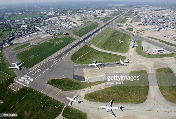 Planes queueing to take off at Heathrow airport in London England