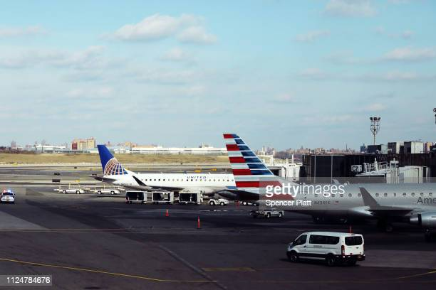 Planes sit on the tarmac at LaGuardia Airport after the Federal Aviation Administration announced it is delaying flights into multiple airports due...