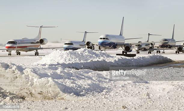 Planes wait in line to take off from O'Hare International Airport February 3 2011 in Chicago Illinois Commercial carriers at the airport started...