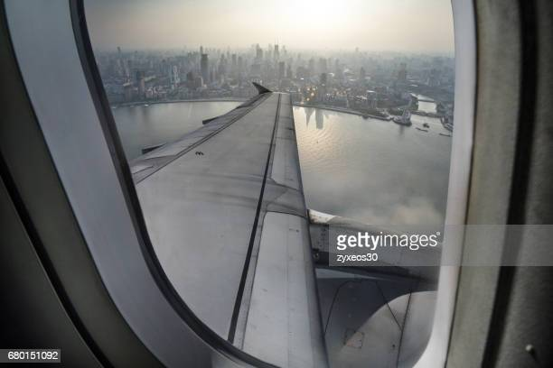 plane's window watch shanghai bund,china - east asia. - china east asia stock pictures, royalty-free photos & images